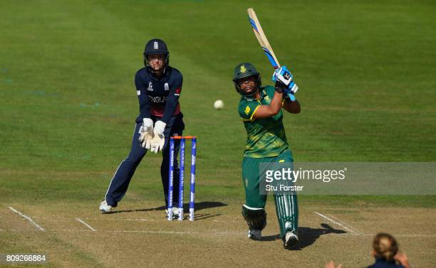 South Africa batsman Chloe Tryon hits out watched by Sarah Taylor during the ICC Women's World Cup 2017 match between England and South Africa at The...