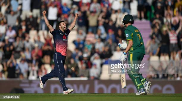 South Africa batsman Chris Morris reacts as Mark Wwood celebrates victory during the 2nd Royal London One Day International between England and South...