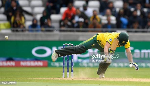 South Africa batsman David Miller is felled by a delivery and given out lbw which he manages to over turn during the ICC Champions Trophy match...