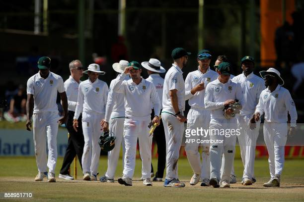 South Africa batsman Dean Elgar holds one of the stumps after South Africa won at the end of the third day of the second Test Match between South...