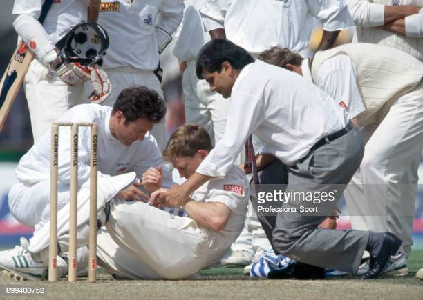 South Africa batsman Jonty Rhodes receives treatment after being hit by a bouncer during the 3rd Test match between England and South Africa at The...