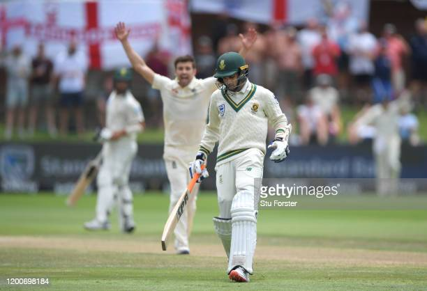 South Africa batsman Keshav Maharaj is run out by Sam Curran as Mark Wood celebrates and England take the final wicket to win the Test Match during...