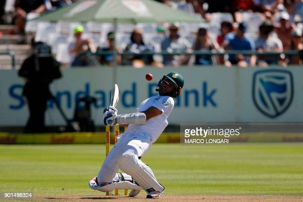 South Africa batsman Keshav Maharaj reacts as India's bowler Jasprit Bumrah plays the ball on the first day of the cricket First Test match between...