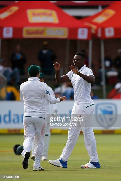 South Africa batsman Lungi Ngidi celebrates taking the wicket of Australia batsman Nathan Lyon during day one of the second Sunfoil Test between...