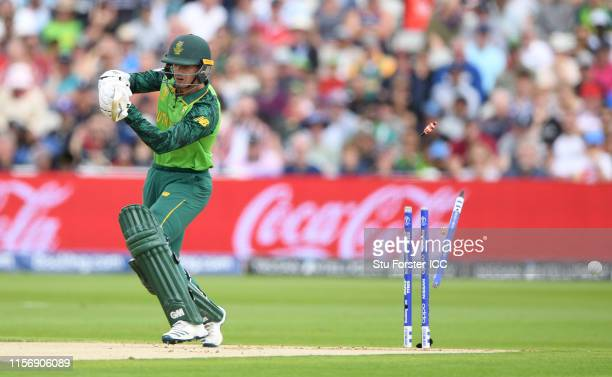 South Africa batsman Quinton de Kock is bowled by Trent Boult during the Group Stage match of the ICC Cricket World Cup 2019 between New Zealand and...