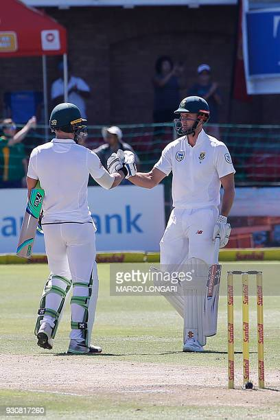 South Africa batsman Theunis de Bruyn and Proteas captain Faf du Plessis shake hands after winning during day four of the second Cricket Test match...