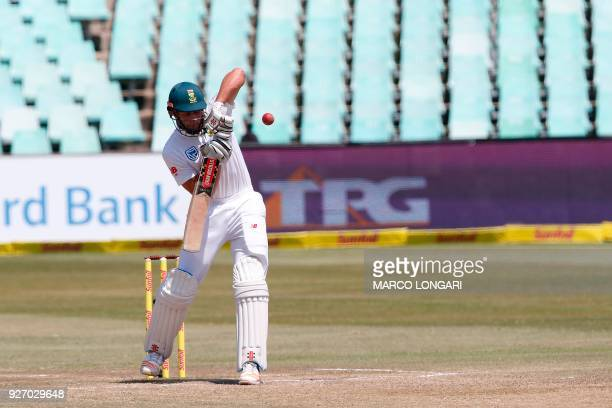 South Africa batsman Theunis de Bruyn hits the ball during the fourth day of the first Test cricket match between South Africa and Australia at The...