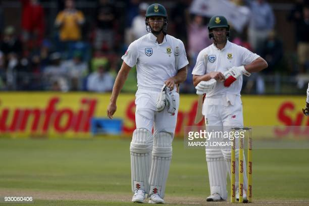 South Africa batsman Theunis de Bruyn leaves the pitch following his dismissal as Australia wicketkeeper Tim Paine looks on during the second days...