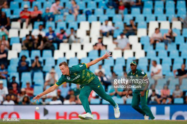 South Africa bowler Chris Morris lunges to catch his own delivery during the sixth One Day International cricket match between South Africa and India...
