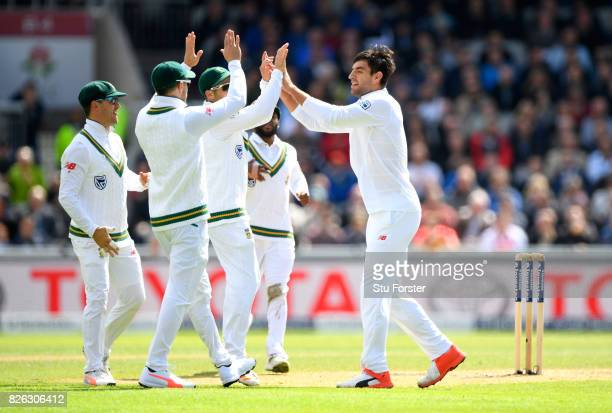 South Africa bowler Duanne Olivier celebrates with team mates after dismissing Keaton Jennings during day one of the 4th Investec Test match between...