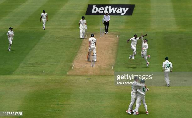 South Africa bowler Kagiso Rabada celebrates after dismissing England batsman Dom Sibley during Day One of the Second Test between England and South...