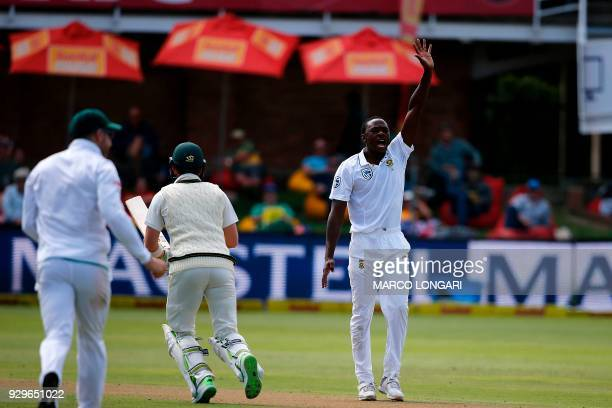 South Africa bowler Kagiso Rabada celebrates taking the wicket of Shaun Marsh during day one of the second Sunfoil Test between South Africa and...
