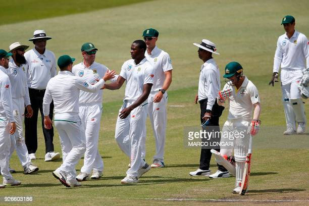 South Africa bowler Kagiso Rabada celebrates the wicket of Australia batsman David Warner during day three of the first Sunfoil Test between South...