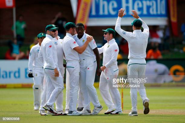 South Africa bowler Kagiso Rabada is celebrated after taking the wicket of Australia batsman and captain Steve Smith during day one of the second...