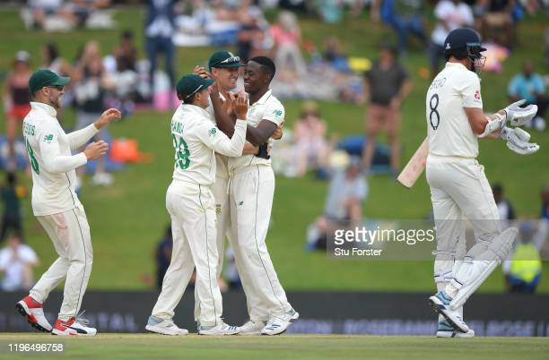 South Africa bowler Kagiso Rabada is congratulated after taking the final wicket of Stuart Broad to win the match for South Africa during Day Four of...