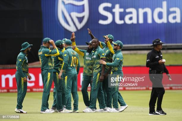 South Africa bowler Kagiso Rabada is congratulated by his teammates after dismissing India batsman Shikhar Dhawan during the fifth One Day...