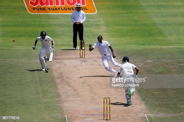 South Africa bowler Kagiso Rabada reaches for the ball as India batsmen Hardik Pandya and Bhuvneshwar Kumar run during the second day of the first...