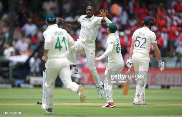 South Africa bowler Kakiso Rabada celebrates after dismissing England batsman Dom Sibley during Day One of the Second Test between England and South...