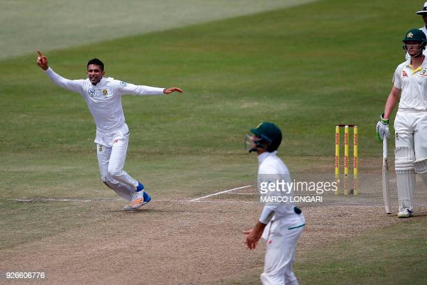 South Africa bowler Keshav Maharaj celebrates the wicket of Australia batsman Usman Khawaja during day three of the first Sunfoil Test between South...
