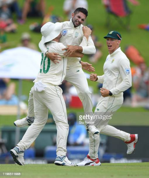 South Africa bowler Keshav Maharaj celebrates with team mates after bowling Ben Stokes during Day Four of the First Test match between England and...