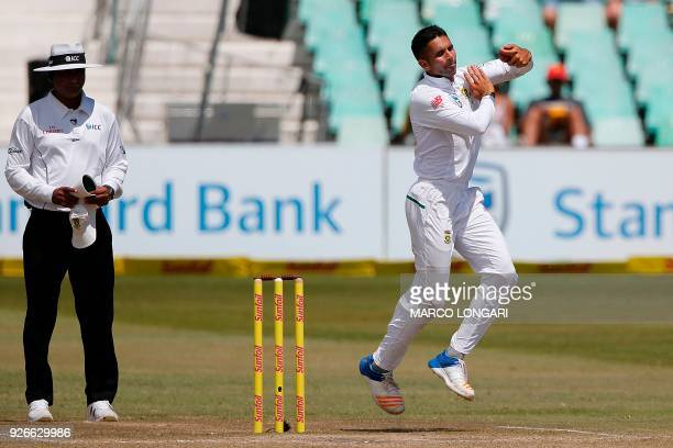 South Africa bowler Keshav Maharaj delivers the ball during day three of the first Sunfoil Test between South Africa and Australia at the Kingsmead...