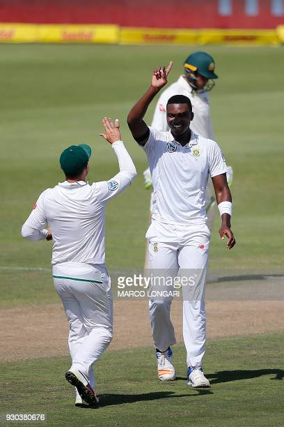 South Africa bowler Lungi Ngidi celebrates after taking the wicket of Australia batsman Cameron Bancroft during day three of the second Test cricket...