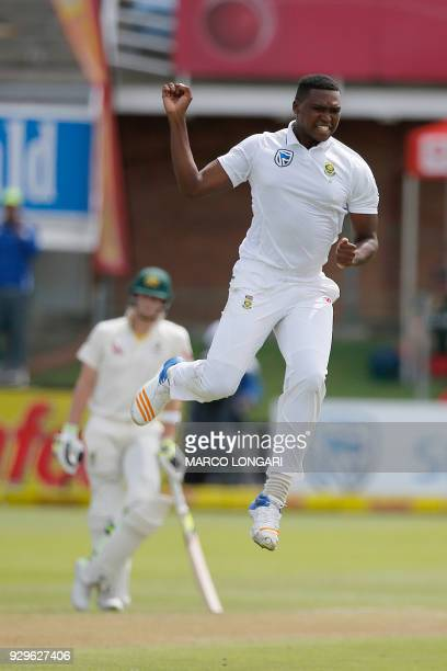 South Africa bowler Lungi Ngidi celebrates taking the wicket of Australia batsman David Warner during day one of the second Sunfoil Test between...