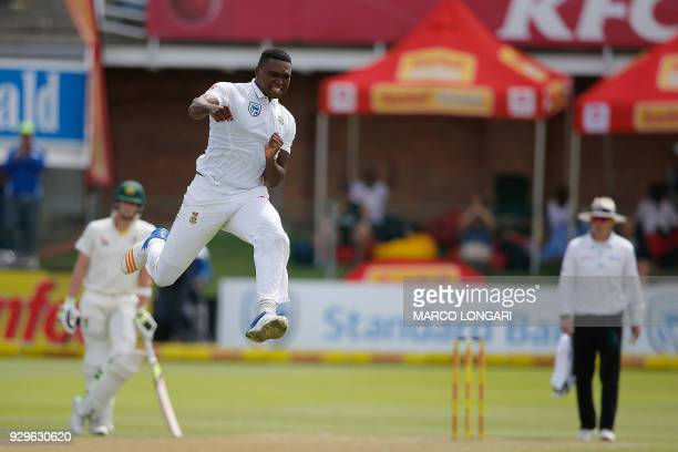 TOPSHOT South Africa bowler Lungi Ngidi celebrates taking the wicket of Australia batsman David Warner during day one of the second Sunfoil Test...