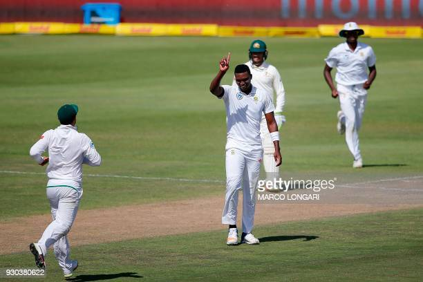 South Africa bowler Lungi Ngidi celebrates taking the wicket of Australia batsman Cameron Bancroft during day three of the second Test cricket match...