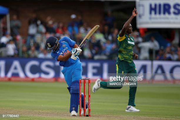 South Africa bowler Lungi Ngidi celebrates the dismissal of India batsman Rohit Sharma during the fifth One Day International cricket match between...