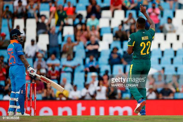 South Africa bowler Lungi Ngidi celebrates the dismissal of India batsman Shikhar Dhawan during the sixth One Day International cricket match between...