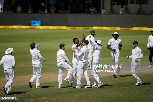 South Africa bowler Lungi Ngidi celebrates with teammates after taking the wicket of Australia batsman Cameron Bancroft during day three of the...
