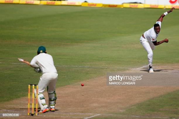 South Africa bowler Lungi Ngidi delivers the ball to Australia batsman Usman Khawaja during day three of the second Test cricket match between South...