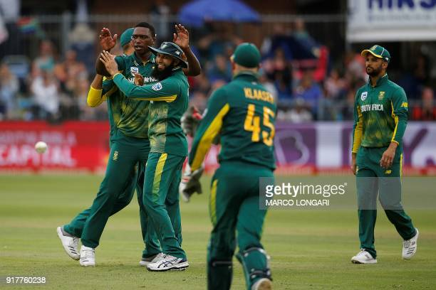 South Africa bowler Lungi Ngidi is congratulated by teammates after dismissing India batsman Hardik Pandya during the fifth One Day International...
