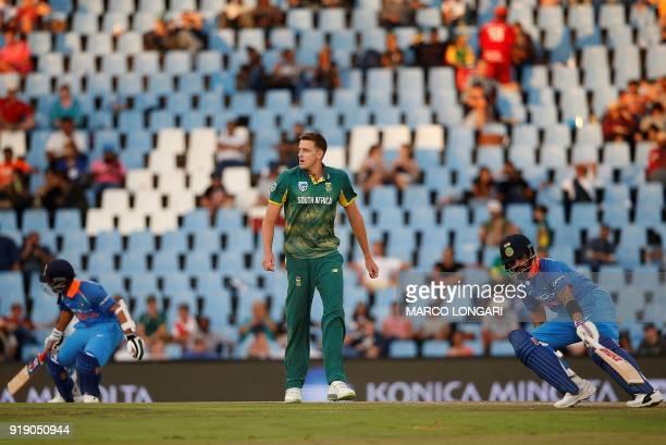 South Africa bowler Morne Morkel looks on while India batsman Virat Kohli and Ajinkya Rahane run during the sixth One Day International cricket match...