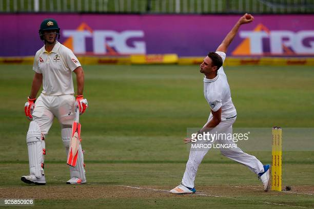 South Africa bowler Theunis de Bruyn is watched by Australian batsman Mitchell Marsh as he delivers a ball during play on the first day of the first...