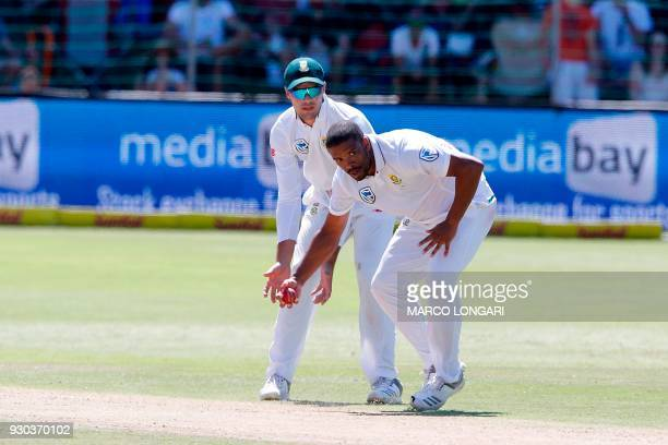 South Africa bowler Vernon Philander catches his own delivery during day three of the second Test cricket match between South Africa and Australia at...