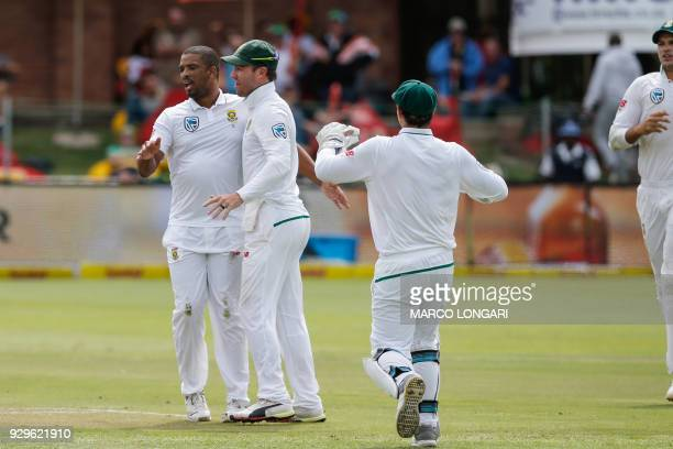 South Africa bowler Vernon Philander celebrates taking the wicket of Australia batsman Usman Khawaja during day one of the second Sunfoil Test...