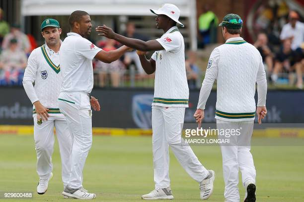 South Africa bowler Vernon Philander celebrates together with team members taking the wicket of Australia batsman Cameron Bancroft during day one of...