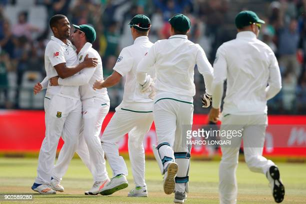 South Africa bowler Vernon Philander is celebrated by teammates for dismissing India batsman Mohammed Shami during day four of the First Test between...
