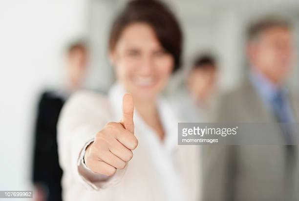 South Africa, Businesswoman with thumbs-up