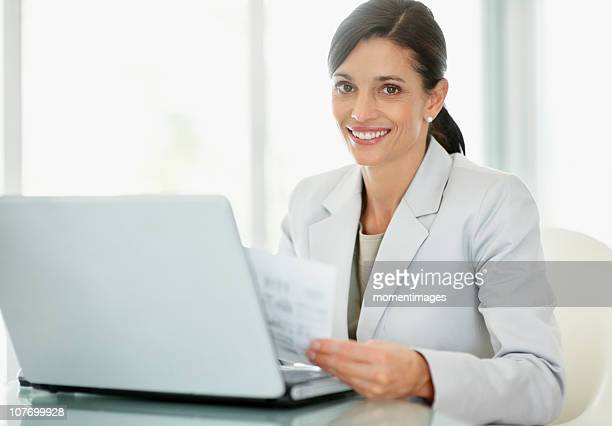 South Africa, Businesswoman working on laptop