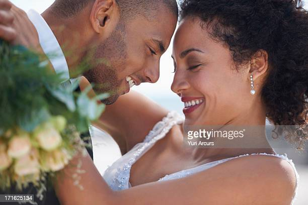 South Africa, Cape Town, Bride and groom embracing