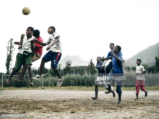 South Africa, Cape Town, Hout Bay, boys (14-17) and men playing soccer