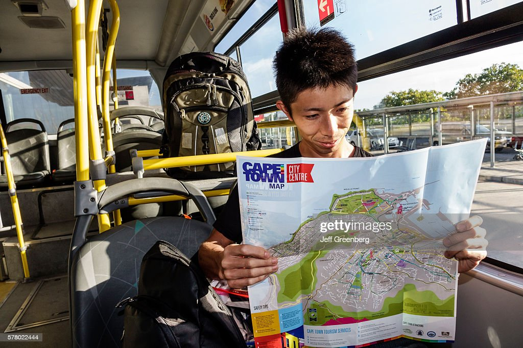 Cape Town International Airport terminal man reading map bus