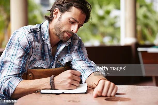 south africa, cape town, man doing notes - authors foto e immagini stock