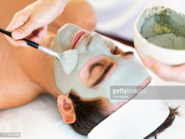 South Africa, Cape Town, Man receiving face spa therapy