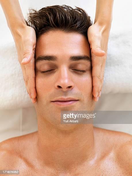 south africa, cape town, man receiving massage in spa - human body part stock-fotos und bilder