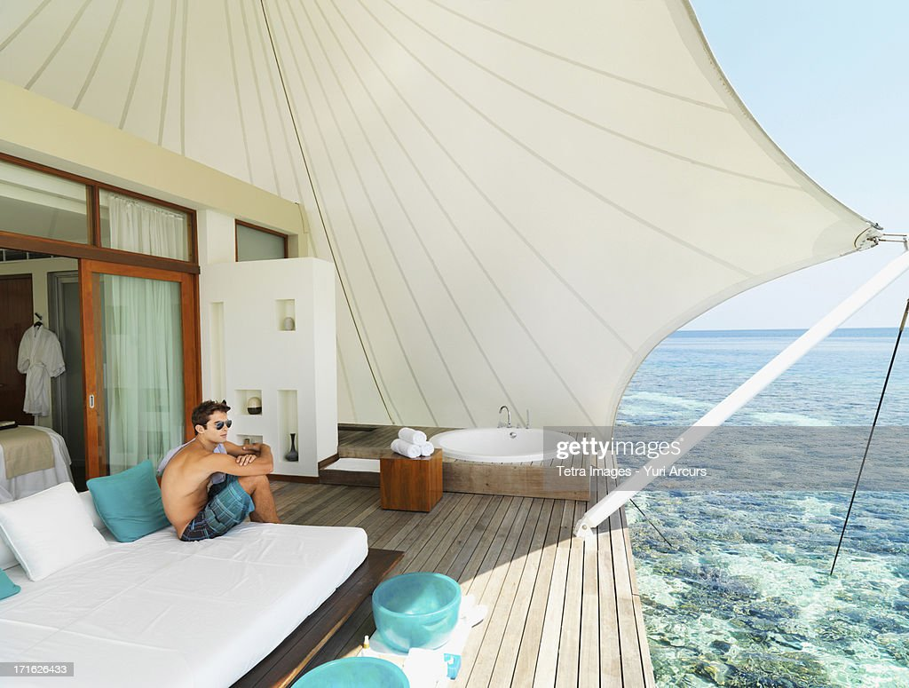 South Africa, Cape Town, Man sitting on deck relaxing : Stock Photo