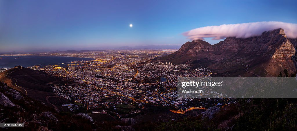 South Africa, Cape Town, panoramic view of cape town with signal hill and table mountain seen from lion's head at full moon : Stock Photo